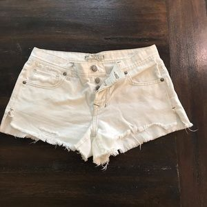 Free People distressed white jean shorts